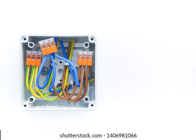 electrical wiring junction box with wires and terminals on white background  with copy space