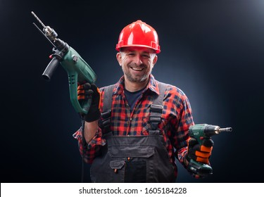 electrical worker with a pneumatic drill presses