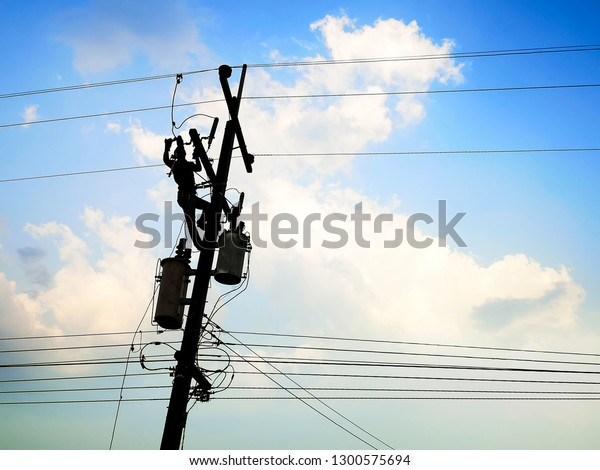 Electrical working on high voltage pole , put safety equipment