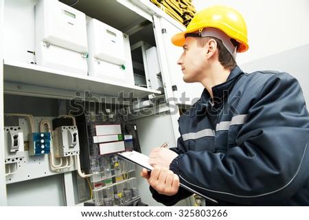 electrician builder engineer inspector checking data stock photoelectrician builder engineer inspector checking data of equipment in fuse box