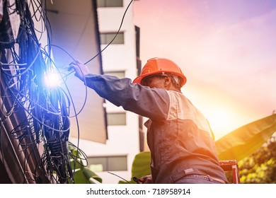 The electrician is checking the electrical system of the apartment,Because of the short circuit.It may cause fire to the building.Electrical system development.