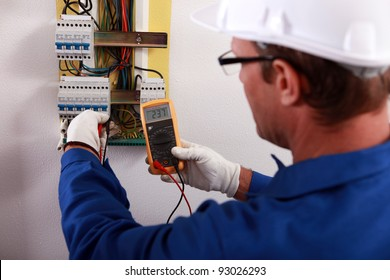 An electrician checking the energy meter.