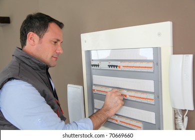 Electrician checking switchboard