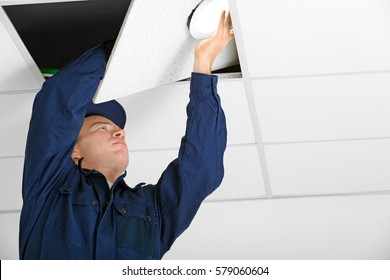 Electrician checking wiring in office