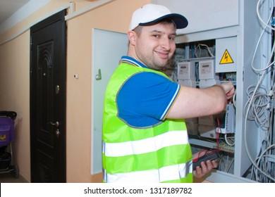 electrician checks electric board