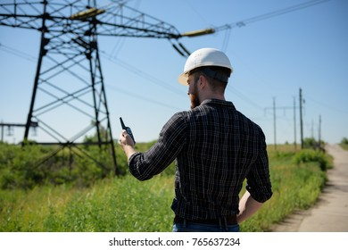 The electrician checks the power line. Ukraine. Donetsk. 05.06.2017.