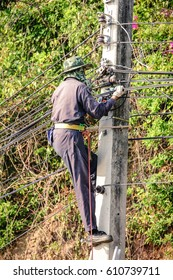 Electrician climb electric pole