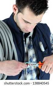 Electrician clipping electric cable