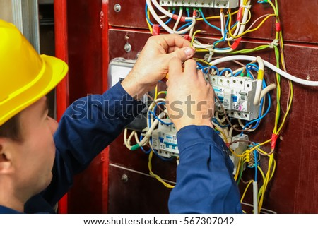 Peachy Electrician Connecting Wires Distribution Board Stock Photo Edit Wiring Digital Resources Sapredefiancerspsorg