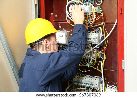 Fine Electrician Connecting Wires Distribution Board Stock Photo Edit Wiring Digital Resources Sapredefiancerspsorg