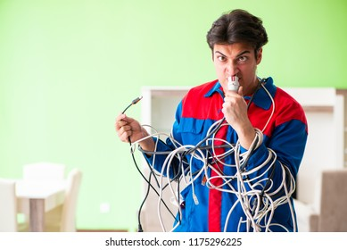 Electrician contractor with tangled cables