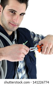 electrician cutting a cable