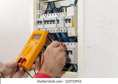 Electrician doing some checks on a light box