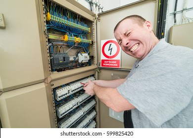 electrician electrocuted. grimace of pain on his face