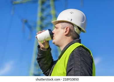 Electrician Engineer drink  near high voltage tower