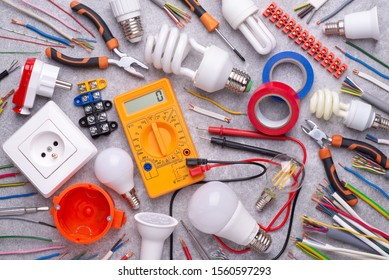 Electrician equipment on gray background, top view