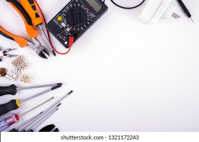 Electrician equipment on white background. Top view