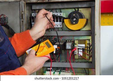 electrician fixing  electrical system with different tools
