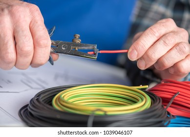 Electrician hands stripping a wire