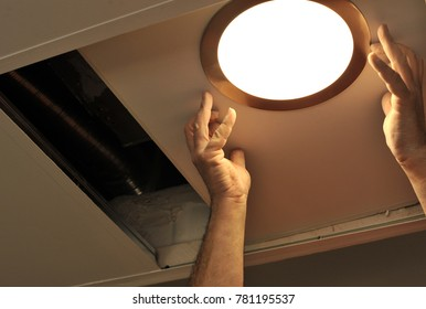 Electrician installing a new light in the house