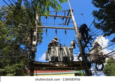 Electrician installing with pole transformer and cables,electrician working at height and dangerous on electric post,Three phase transformer high Voltage