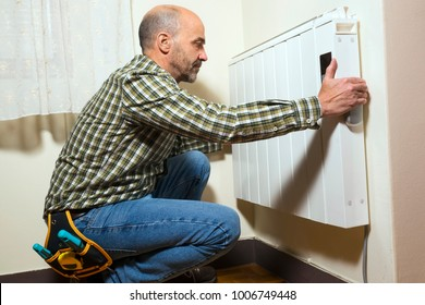electrician installing radiator at home