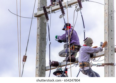 Electrician installing transformer and cables.