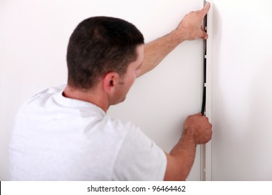 An electrician installing wire.