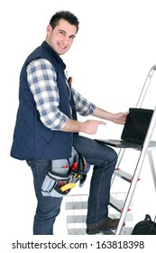 Electrician with a laptop