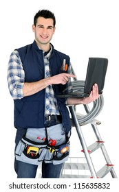 Electrician with laptop and ladder