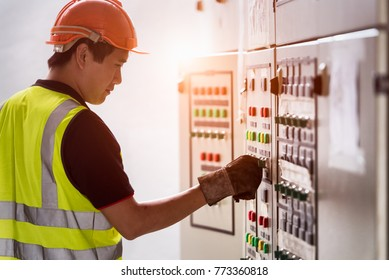 Electrician looking to control panel in the workplace. Engineer works in the industrial quality control jobs concept.