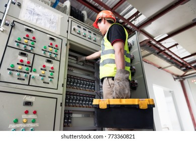 Electrician or Maintenance people working on fuse box in control panel at the workplace. Engineer works with a toolbox in the jobs.
