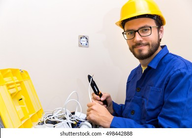 electrician occupation - worker and toolbox with electric accessories