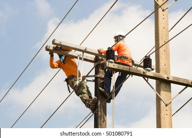 electrician overalls working at height and dangerous on electric post power pole