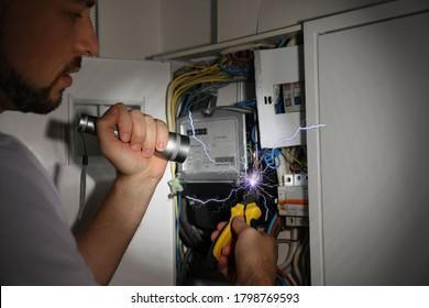 Electrician receiving electric shock while working, closeup