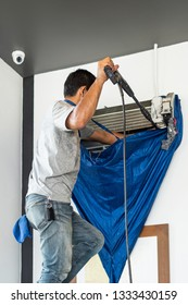 Electrician repairing  and maintenance air conditioning indoors.