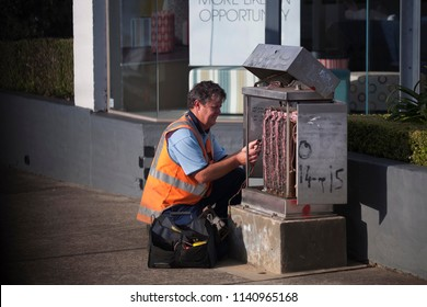 Electrician repairing road traffic light controller distribution box in Sydney city CBD 1/7/18, Australia