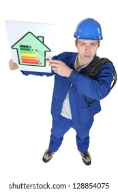 electrician showing the level of energy consumption of a house