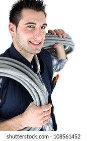 Electrician stood with corrugated cabling