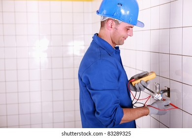 Electrician testing the current with a multimeter