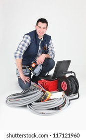 Electrician with a toolbox