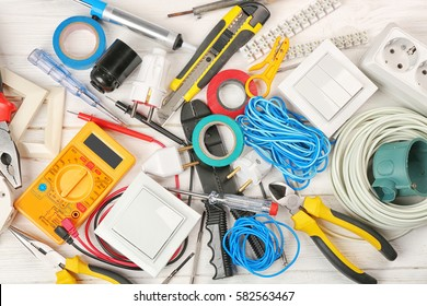Electrician tools on wooden background
