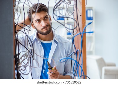 Electrician trying to untangle wires in repair concept