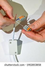 An electrician uses terminals to connect electrical wires.