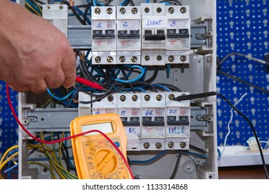 electrician at work with an appliance