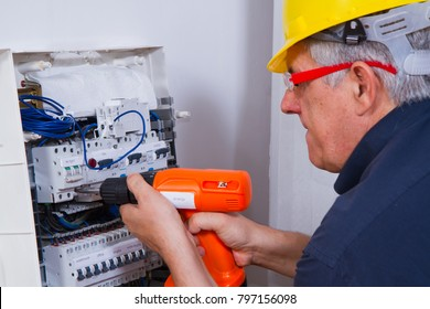 electrician at work with an electric box