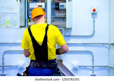 Electrician at work. A man collects electrical wiring. Construction works. Electrician mounts electrical panel. Electro shield. Engineering work on the construction of the house.