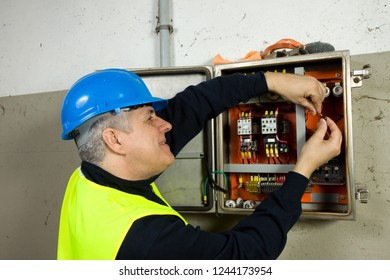 electrician at work in a plant