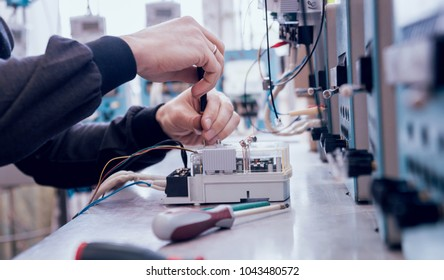 Electrician worker checking electricity meters. Electrical equipment. Background
