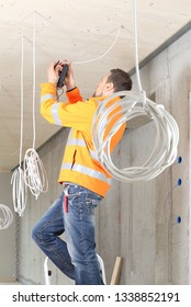 A  Electrician working in New building with cables